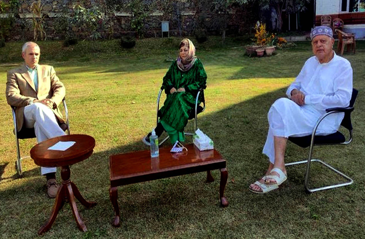 Former Chief Ministers Dr Farooq Abdullah and Omar Abdullah meeting PDP president Mehbooba Mufti at her Gupkar residence in Srinagar on Wednesday.