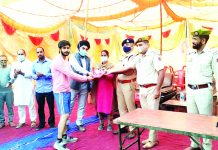 Dignitaries presenting awards to players at Reasi.