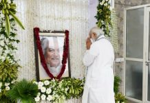 Prime Minister Narender Modi paying tribute to former Gujarat Chief Minister late Keshubhai Patel at his residence in Gandhinagar on Friday. (UNI)