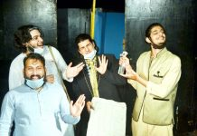 A scene from the play 'Do Kalakaar' staged by Natrang at Jammu on Sunday.