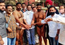 Wrestlers along with dignitaries posing for a group photograph during Dangal at RS Pura.