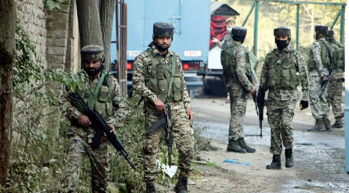 Security forces near encounter site at Barzulla in Srinagar on Monday. —Excelsior/Shakeel