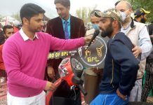 Adil Reshi of Spartans-XI interacting with media after win scooty as Man of the Series in BPL-3 cricket tournament held at Burzhoam Srinagar.