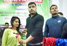 Chief guest presenting medal to a winner at Jammu.