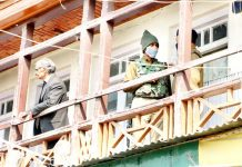 NIA sleuths at the office of JKCCS at Amira Kadal in Srinagar on Wednesday. -Excelsior/Shakeel