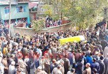Large number of people participating in funeral procession of youth BJP leader in Kulgam on Friday. -Excelsior/ Sajad Dar