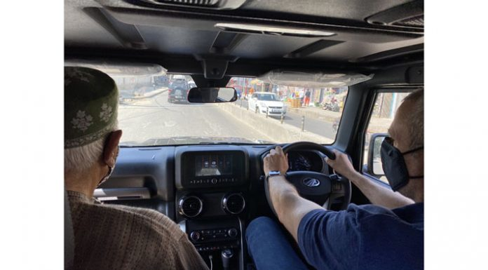 NC leaders Dr Farooq Abdullah and Omar Abdullah take a ride on Mahindra's Thar jeep in Srinagar on Monday.