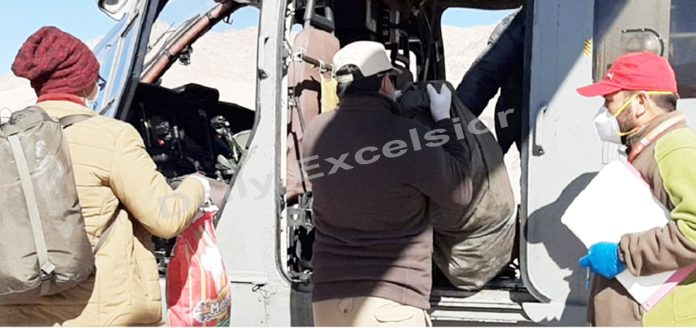 Polling staff boarding a chopper at Leh on Tuesday.-Excelsior/ Morup Stanzin