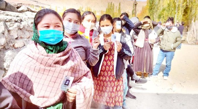 Women voters in a queue in front of a polling booth in Leh on Thursday. -Excelsior/Morup Stanzin