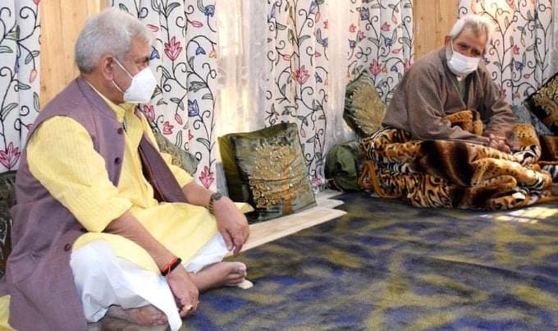 Lieutenant Governor Manoj Sinha with family members of Advocate Babar Qadri in Srinagar on Thursday. — Excelsior/Shakeel