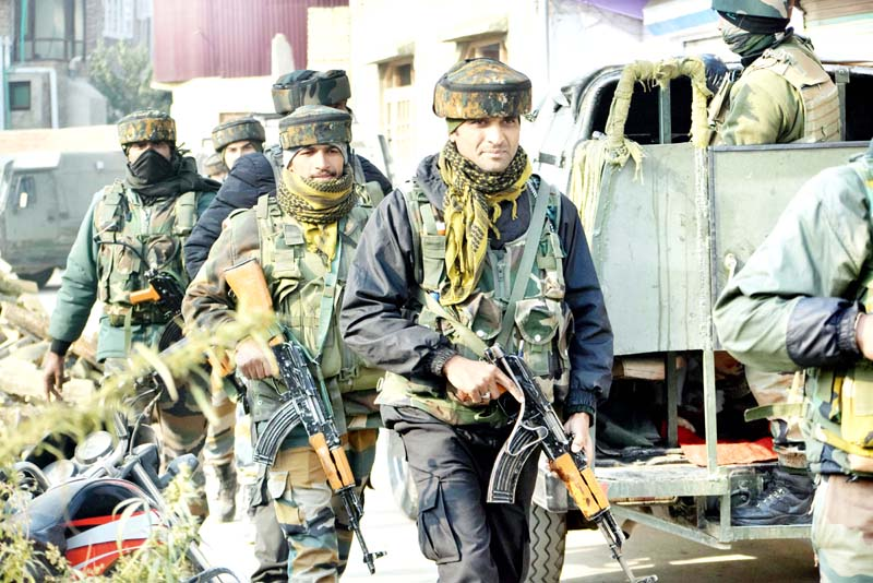 Security Forces near encounter site at Mouchwa in Budgam on Wednesday. -Excelsior/Shakeel