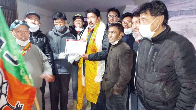 A candidate gets victory certificate in Leh on Monday.