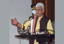 Lieutenant Governor Manoj Sinha addressing a press conference in Srinagar on Thursday.
