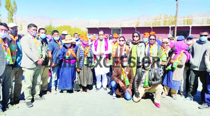 Union Minister, Mukhtar Abbas Naqvi posing with people during an election meeting at Chushot, Leh on Friday. -Excelsior/Morup Stanzin