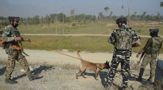 Troops with sniffer dogs at the site of attack on CRPF party at Kandizal, Pampore on Monday. (Inset) The Martyrs.