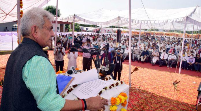 Lieutenant Governor Manoj Sinha addressing the people at Pallanwalla on Friday.