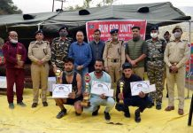 Winner players displaying meritorious certificates along with dignitaries of the event at Doda.