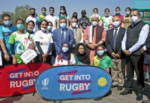 Lt Govenor Manoj Sinha posing for group photograph with young sports persons at Polo Ground, Srinagar on Sunday.
