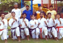 Dignitaries and Karate players posing for a group photograph at Jammu.