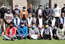 Newly elected office bearers of Leh District Cricket Association posing for group photograph. (Excelsior/Morup Stanzin)