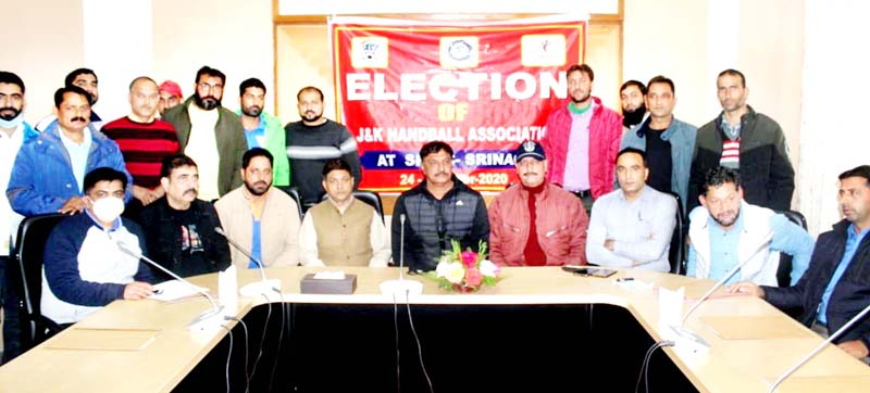 Newly elected office bearers of J&K Handball Association during the meeting at SKICC House, Srinagar.
