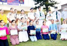 SSP Reasi, Rashmi Wazir along with dignitaries and students posing for a group photograph after the competition at Katra.