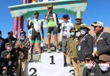 Winners displaying medals along with dignitaries of the event at Leh.