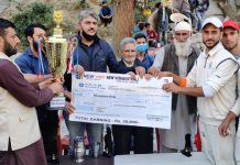 NC leader, Haji Sajjad Shaheen presenting trophy to winning team at Banihal.