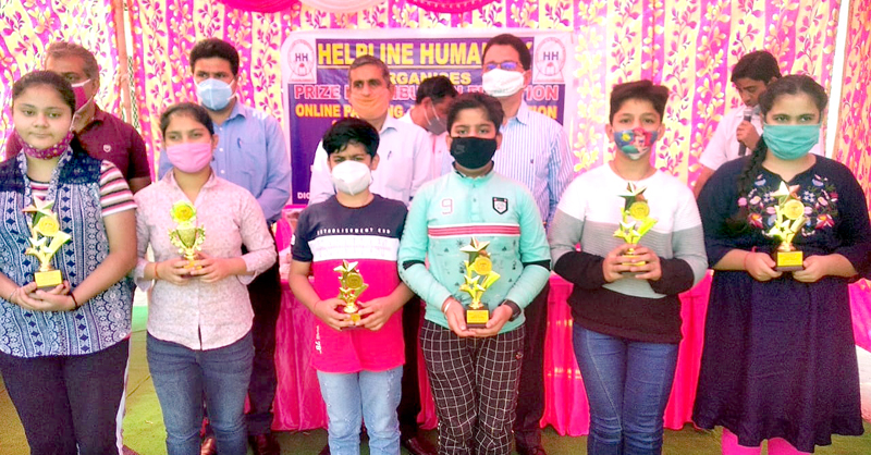 Winner students along with their trophies posing for a group photograph with dignitaries at Jammu.