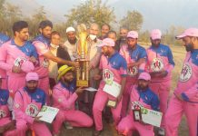 Winner team of PHAAK Cricket Tournament posing for photograph with title trophy.