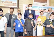 Winner students posing while displaying medals along with dignitaries at Jammu.