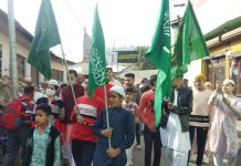 Members of Muslim community taking out a procession in Bhaderwah town on occasion of Eid-Milad-un-Nabi on Friday. -Excelsior/Tilak