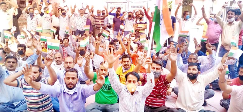 PHE daily rated and consolidated workers staging protest dharna in Jammu on Monday.