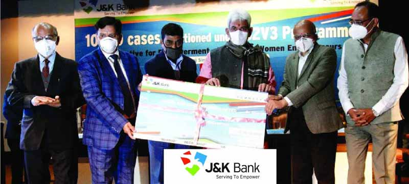 Lieutenant Governor Manoj Sinha handing over cheque to J&K Bank Chairman R K Chhibber at Raj Bhawan.
