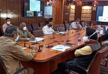 Advisor Baseer Khan chairing a meeting at Srinagar on Thursday.