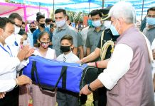 Lt Governor Manoj Sinha handing over sport kits to students at Udhampur during B2V programme.