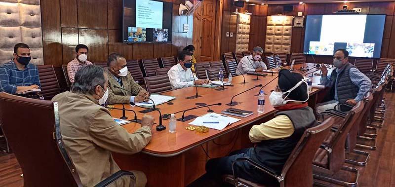 Advisor Baseer Khan chairing a meeting at Srinagar on Thursday.