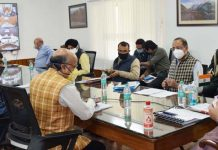 Lt Governor chairing a meeting at Srinagar on Thursday.