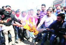 BJYM activists protesting at Dogra Chowk, Jammu on Friday.