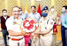 DGP Dilbag Singh being greeted by police officer during meeting at Srinagar.