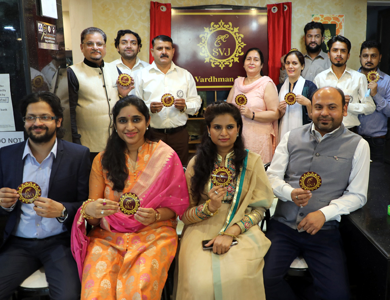 Officials of Shree Vardhman Jewellers unveiling new logo at Jammu on Saturday. —Excelsior/Rakesh
