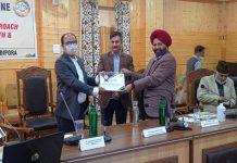 Director ISM J&K Dr Mohan Singh awarding an AYUSH officer in Srinagar.
