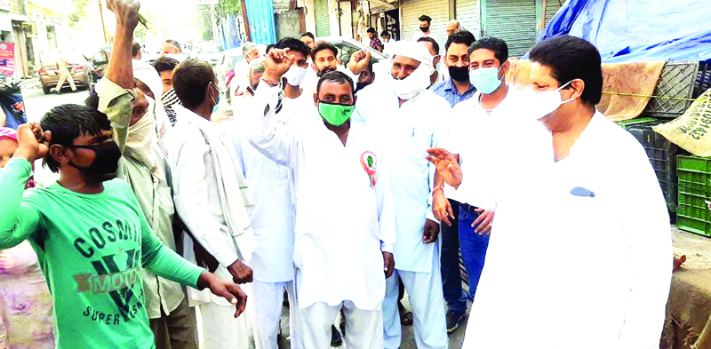 Senior Cong leader Raman Bhalla interacting with people in Gandhi Nagar area of Jammu on Friday.