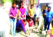 Former MLA, Sat Sharma starting construction works of a lane at Krishna Nagar area of Jammu on Friday.