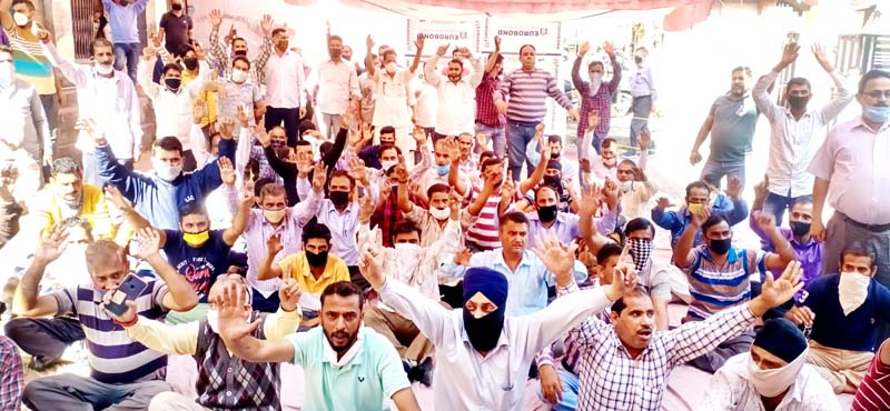 PHE daily rated workers staging protest dharna at BC Road PHE Complex in Jammu on Thursday. -Excelsior/Rakesh