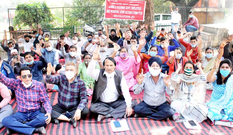 Employees Joint Action Committee members staging protest in Jammu on Thursday. -Excelsior/Rakesh