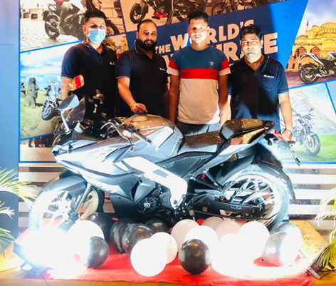 Jammu Motors officials launching new colour options for its Pulsar NS and RS series of motorcycles.