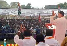 Congress leader Rahul Gandhi addresses a gathering during an election rally, in West Champaran.