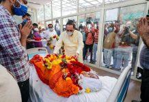 Gujarat Chief Minister Vijay Rupani paying his last respects to former CM Keshubhai Patel during his last rites at his residence, in Gandhinagar.