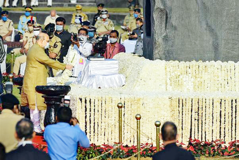 Union Home Minister Amit Shah lays a wreath at the Police Memorial on the occasion of the National Police Commemoration Day, in New Delhi.